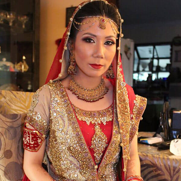 Beautiful Bride with makeup hair Dupatta and jewelry setting.